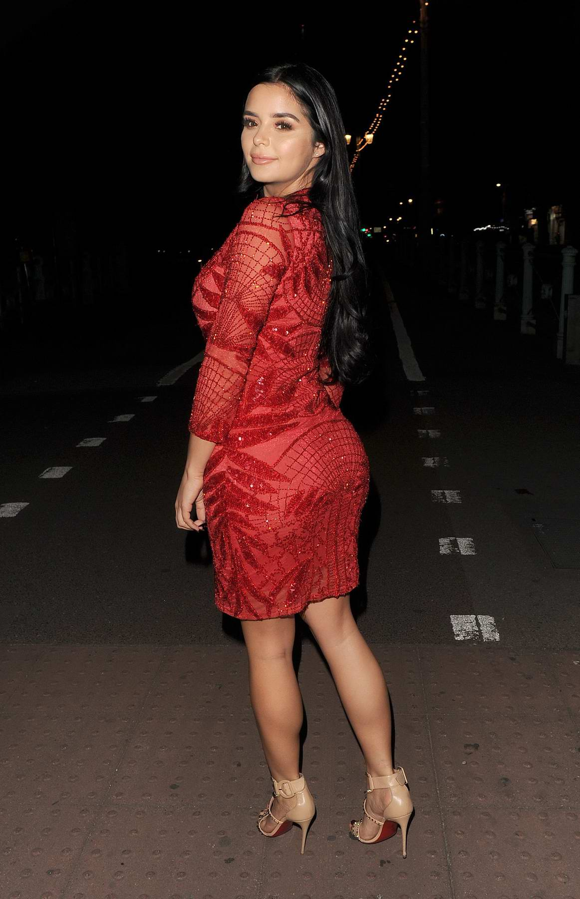 Demi Rose Mawby in a sheer red dress while out at Shoosh nightclub in London