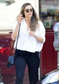 Elizabeth Olsen leaves a waxing salon sporting a baggy white shirt and a black pair of pants in Los Angeles