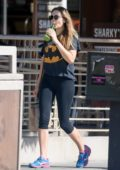 Elizabeth Olsen sip on a green juice while she picks up breakfast at Kreation in Los Angeles