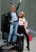 Elsa Hosk and Martha Hunt pose with their luggage as they head to Shanghai, China for the Victoria's Secret fashion Show