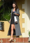 Emily Ratajkowski wears a polka dot dress and a long grey coat as she leaves a friends house in Los Angeles