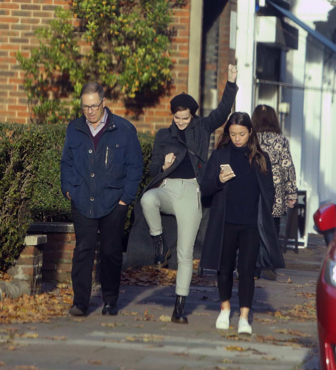 Emma Watson seen messing around and doing a silly dance while out walking with friends in North London