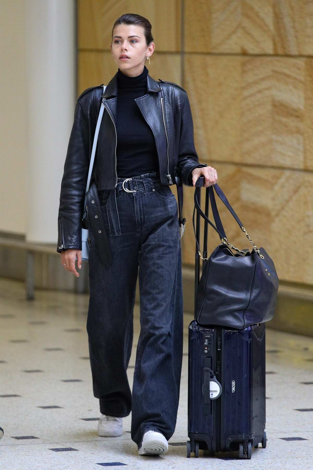 Georgia Fowler in a leather jacket over a black turtle-neck seen arriving at Sydney International Airport, Australia