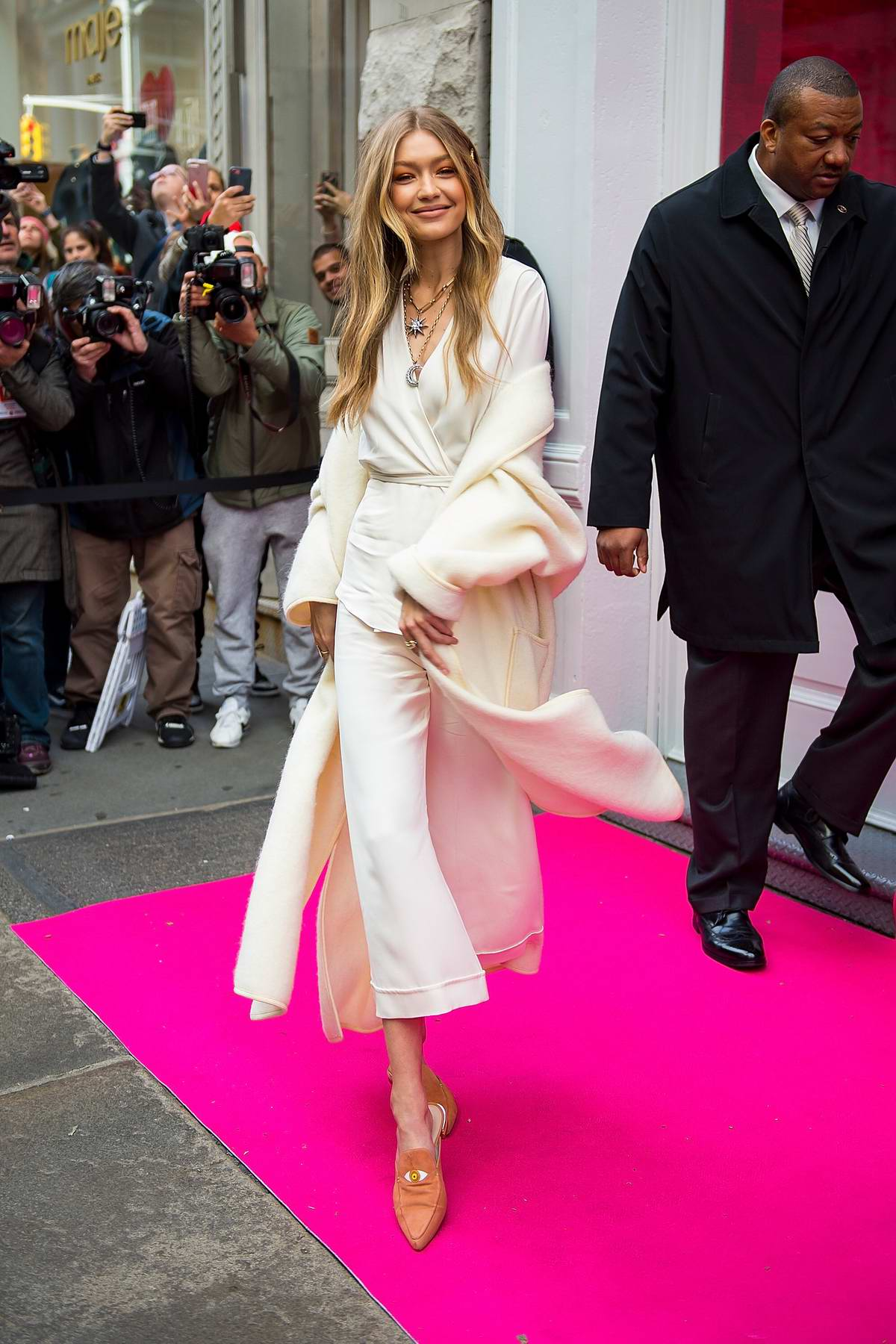 Gigi Hadid poses for fans as she attends the Stuart Weitzman store opening in New York