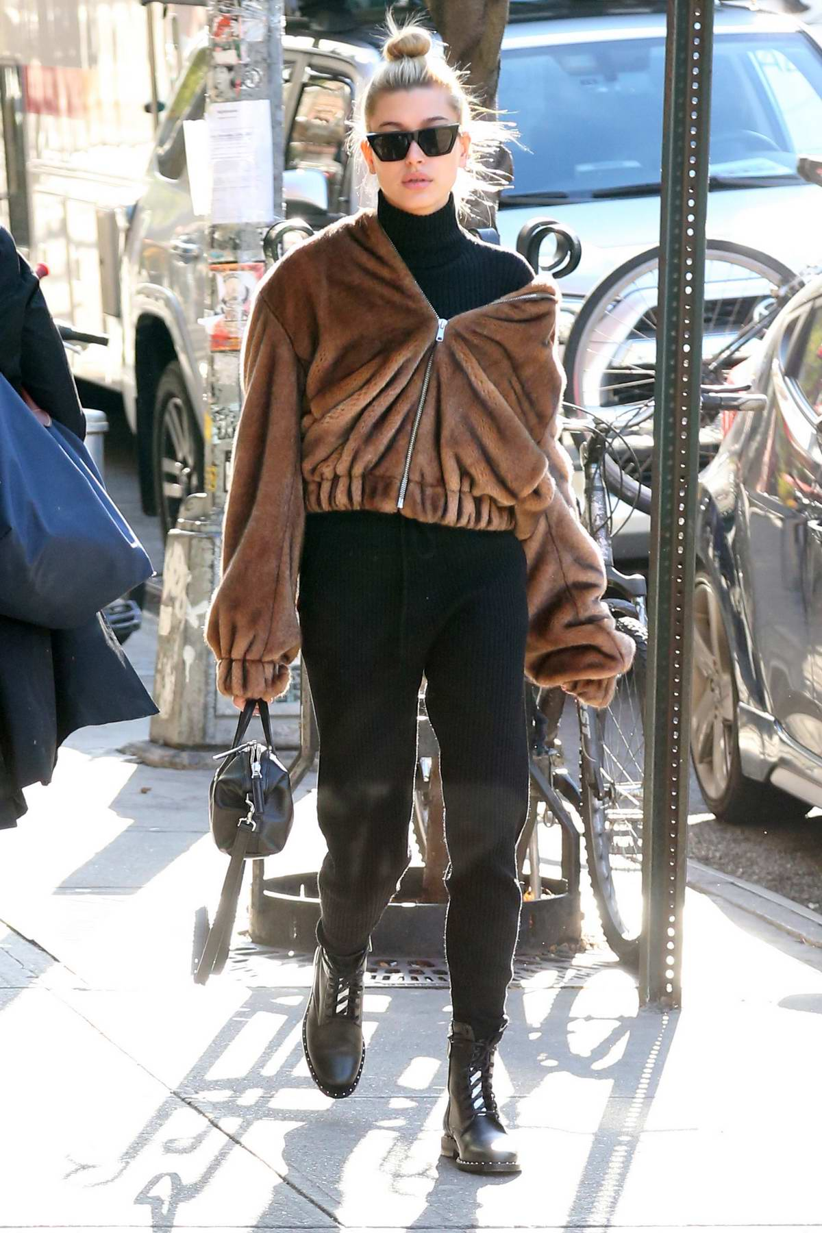 Hailey Baldwin dressed for winters as she heads out in New York City