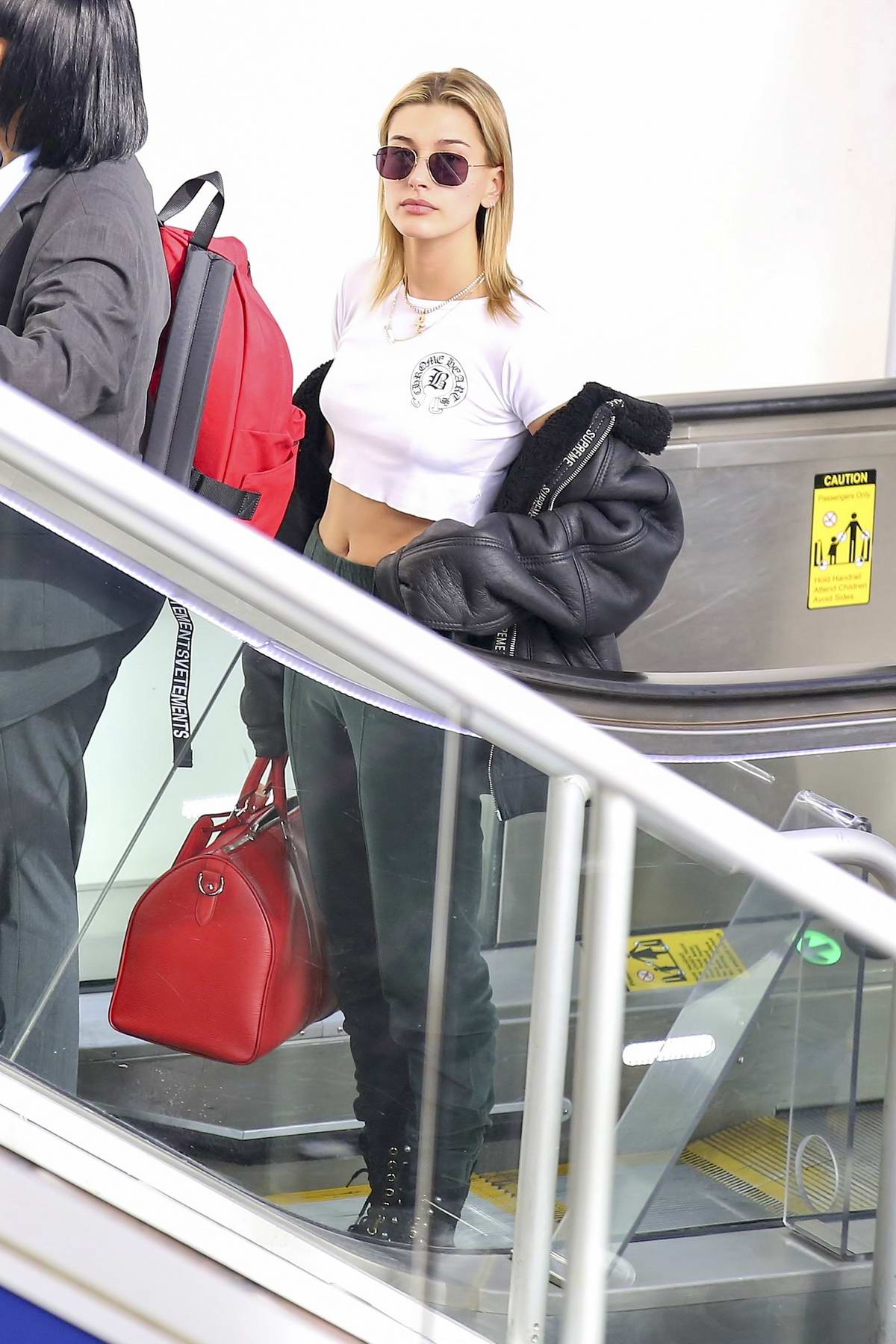 Hailey Baldwin in a crop top going through security at LAX airport in Los Angeles