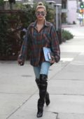 Hailey Baldwin wears a plaid shirt with blue jeans and leather boots to lunch at Zinque Café in West Hollywood