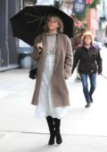 Haley Bennett carries an umbrella while out on the Lower East side, New York