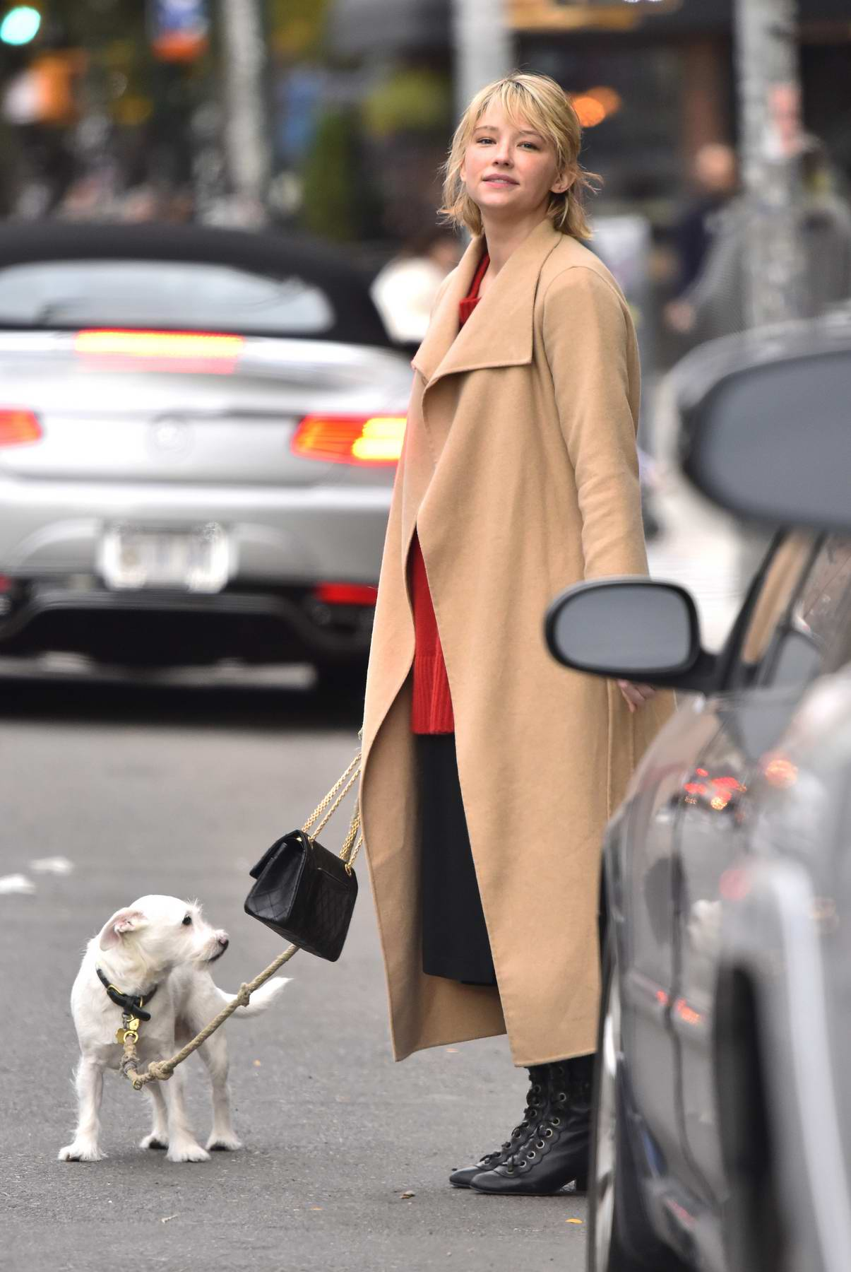 Haley Bennett walking her dog outside The Bowery Hotel in New York City