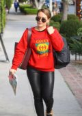Hilary Duff was spotted with a red Gucci sweater as she arrived at the hair salon in West Hollywood, Los Angeles