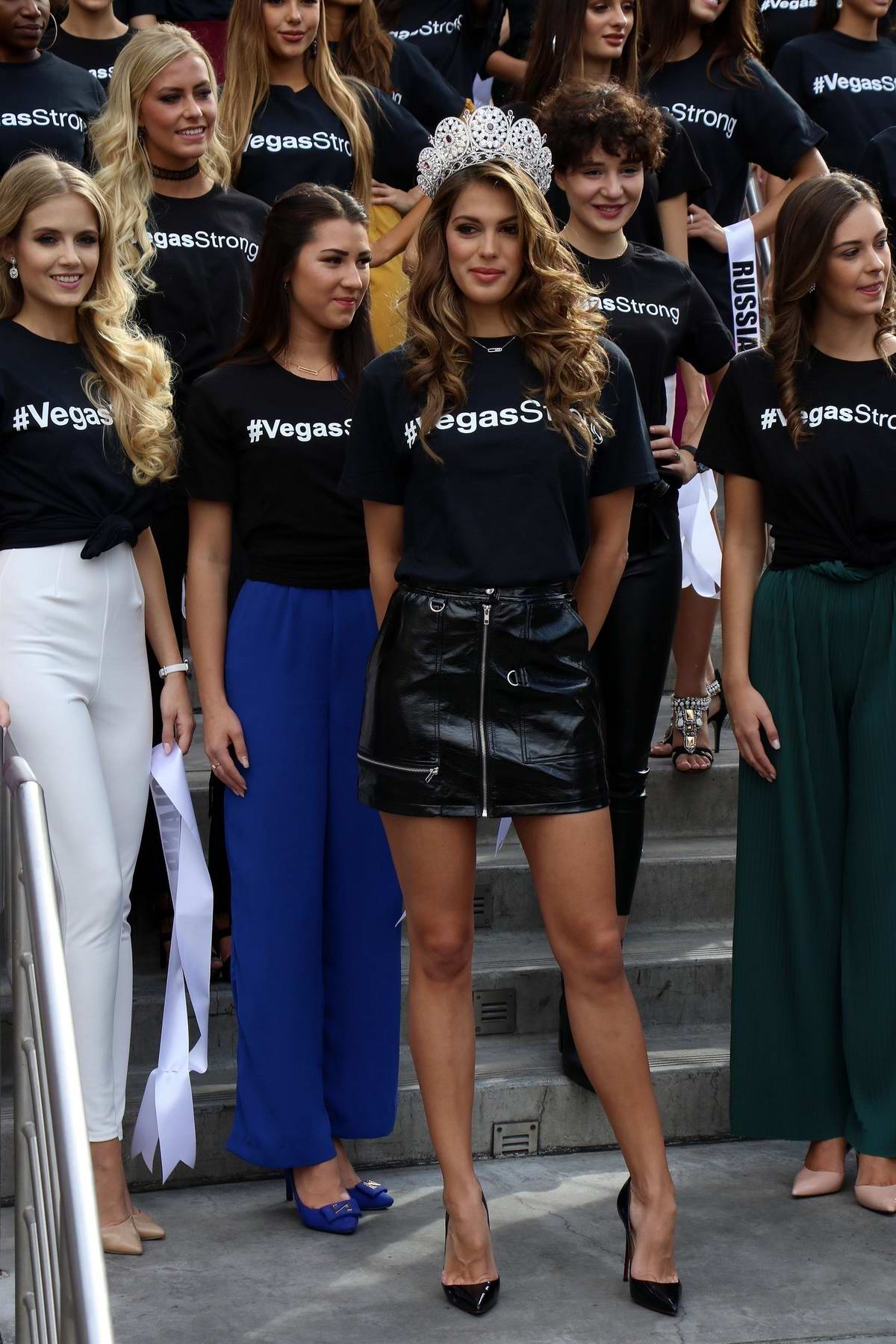 Iris Mittenaere poses as Miss Universe contestants arrive at a welcome event at Planet Hollywood Resort & Casino in Las Vegas