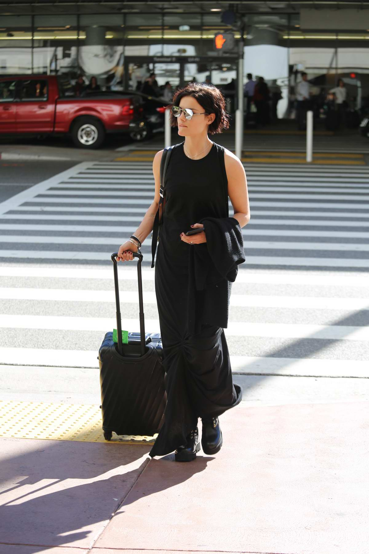 Jaimie Alexander dressed in all black as she arrives at LAX airport in Los Angeles