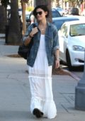 Jaimie Alexander dressed in denim jacket over a white dress while out and about in Studio City, Los Angeles