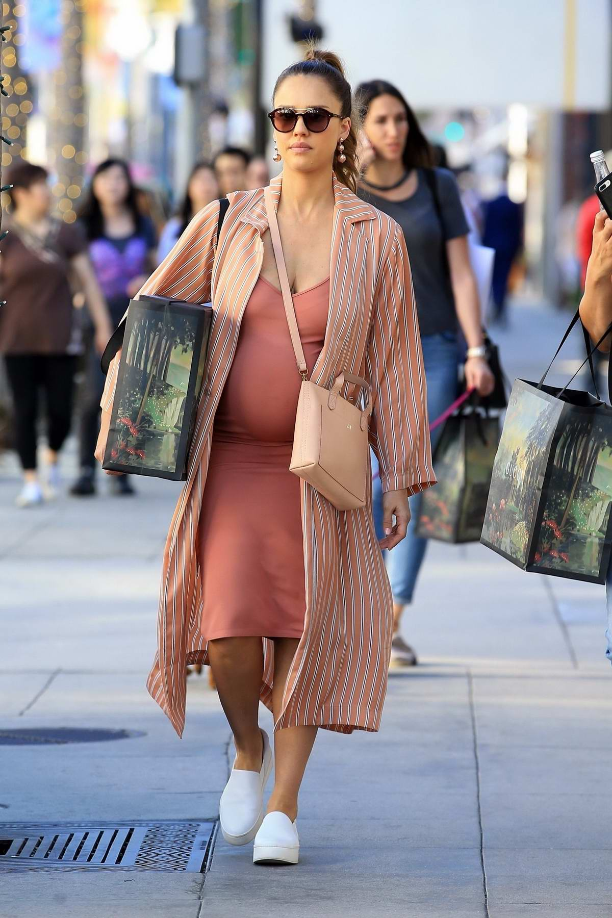 Jessica Alba in a peach dress grabs a few items at Gucci on Rodeo Drive in Beverly Hills, Los Angeles