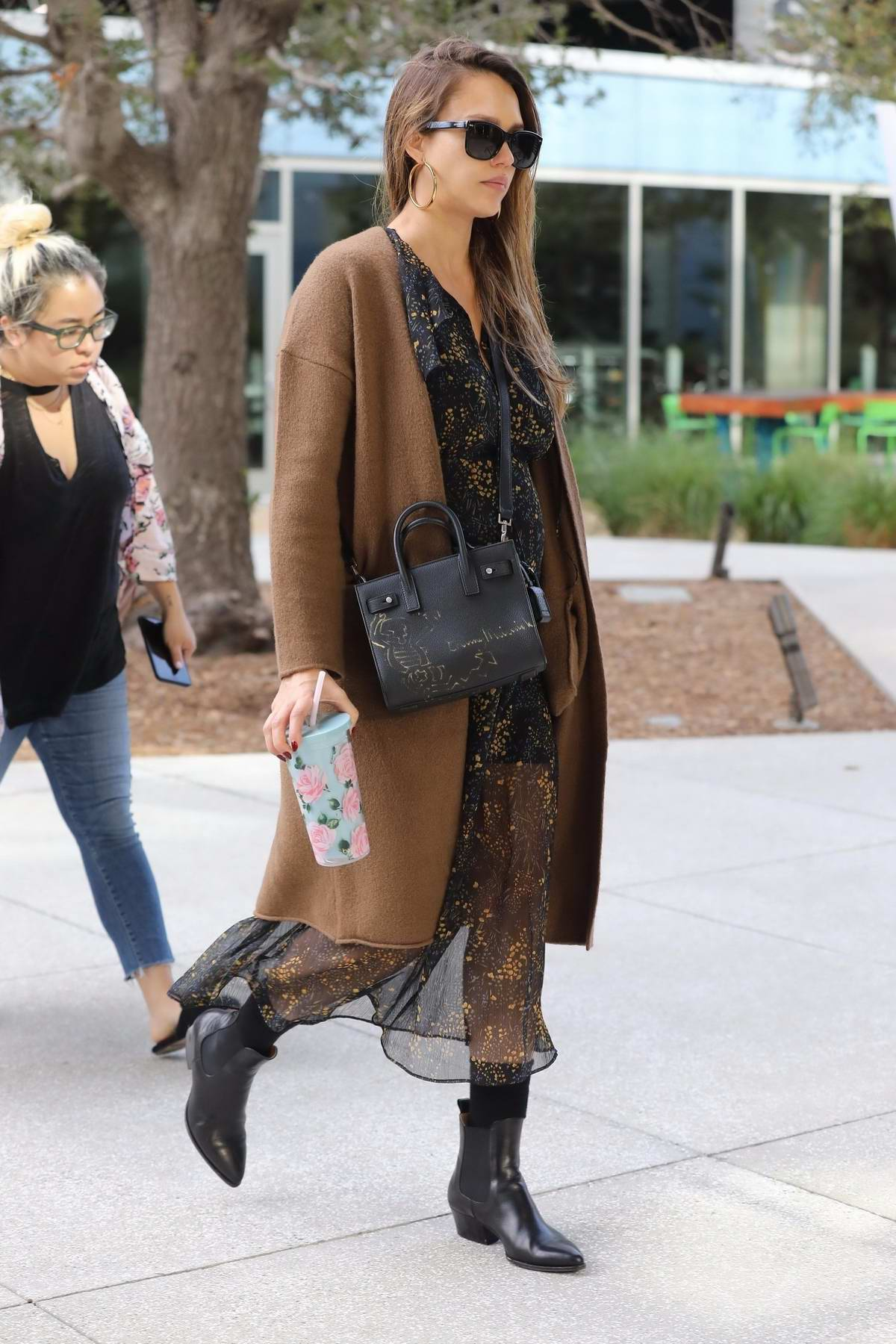 Jessica Alba in floral print dress arrives for work at the Honest Company in Los Angeles