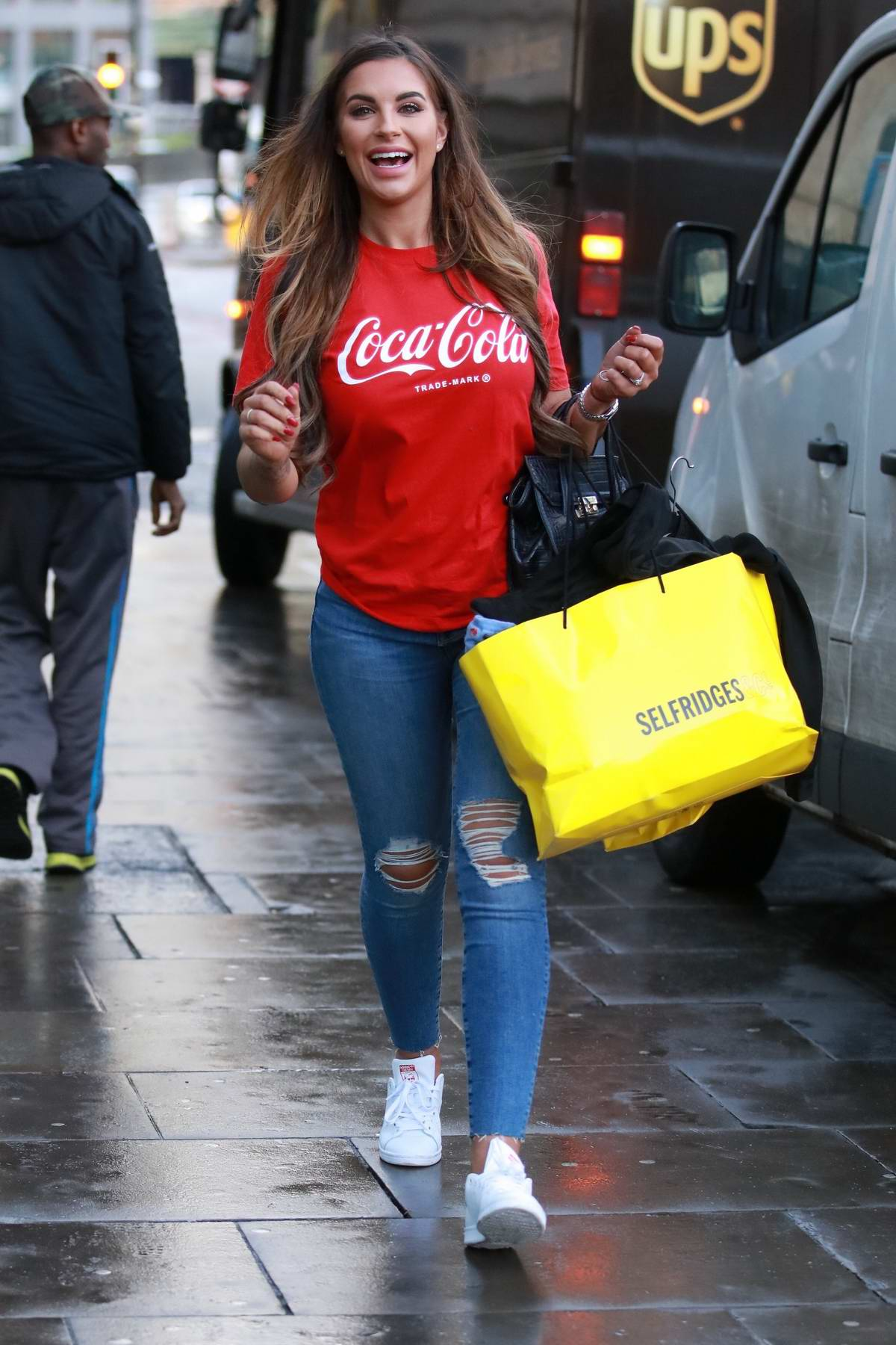 Jessica Shears wore a red coca cola t-shirts and ripped jeans while shopping in Manchester, UK