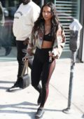 Karrueche Tran goes casual in a camo jacket after lunch in Los Angeles