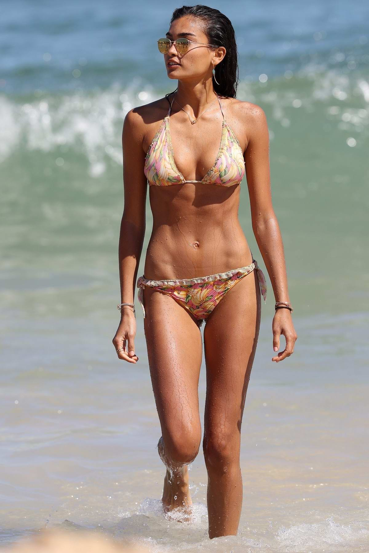 Kelly Gale in a bikini enjoying a beach outing with her partner in Bondi, Sydney, Australia