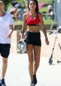 Kelly Gale walks with her boyfriend in Victoria Sport fitness wear at Bronte beach in Sydney, Australia