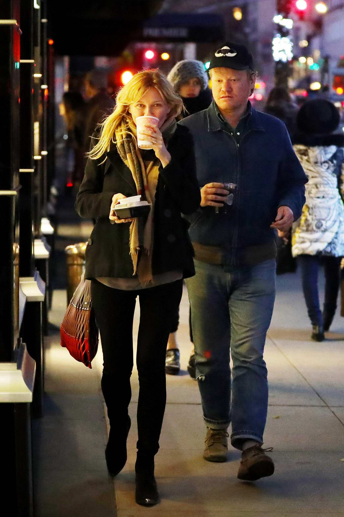 Kirsten Dunst and fiance Jesse Plemons enjoy a romantic nighttime stroll in New York City