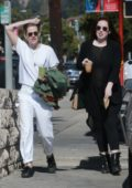 Kristen Stewart dressed in white out and about with a friend in Los Angeles