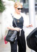 Kylie Minogue leaving her house wearing dark sunglasses in London