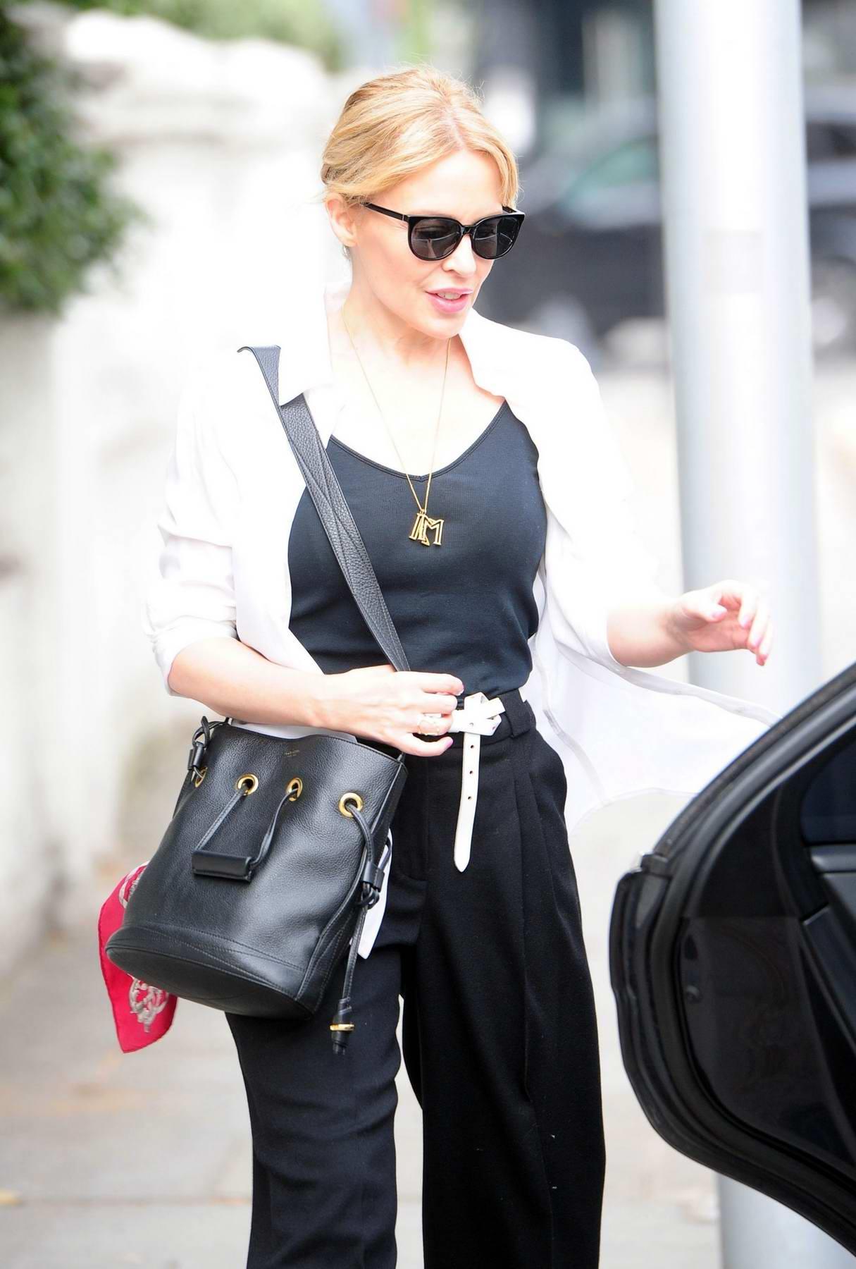 Kylie Minogue leaving her house wearing dark sunglasses in ...