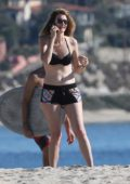 Laura Dern wearing a bikini top and shorts for an unusually warm day in Malibu, California