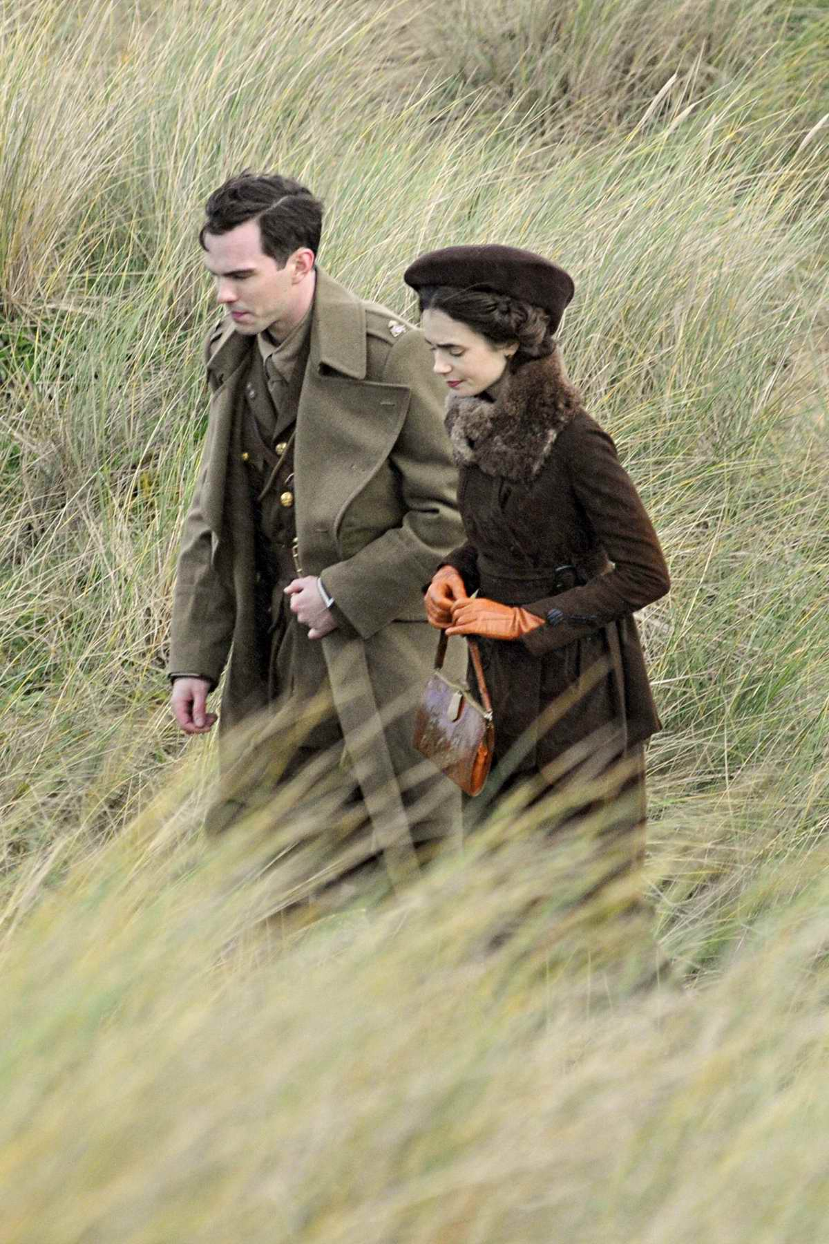 Lily Collins and Nicholas Hoult are seen on the set their new film in Merseyside, England, UK
