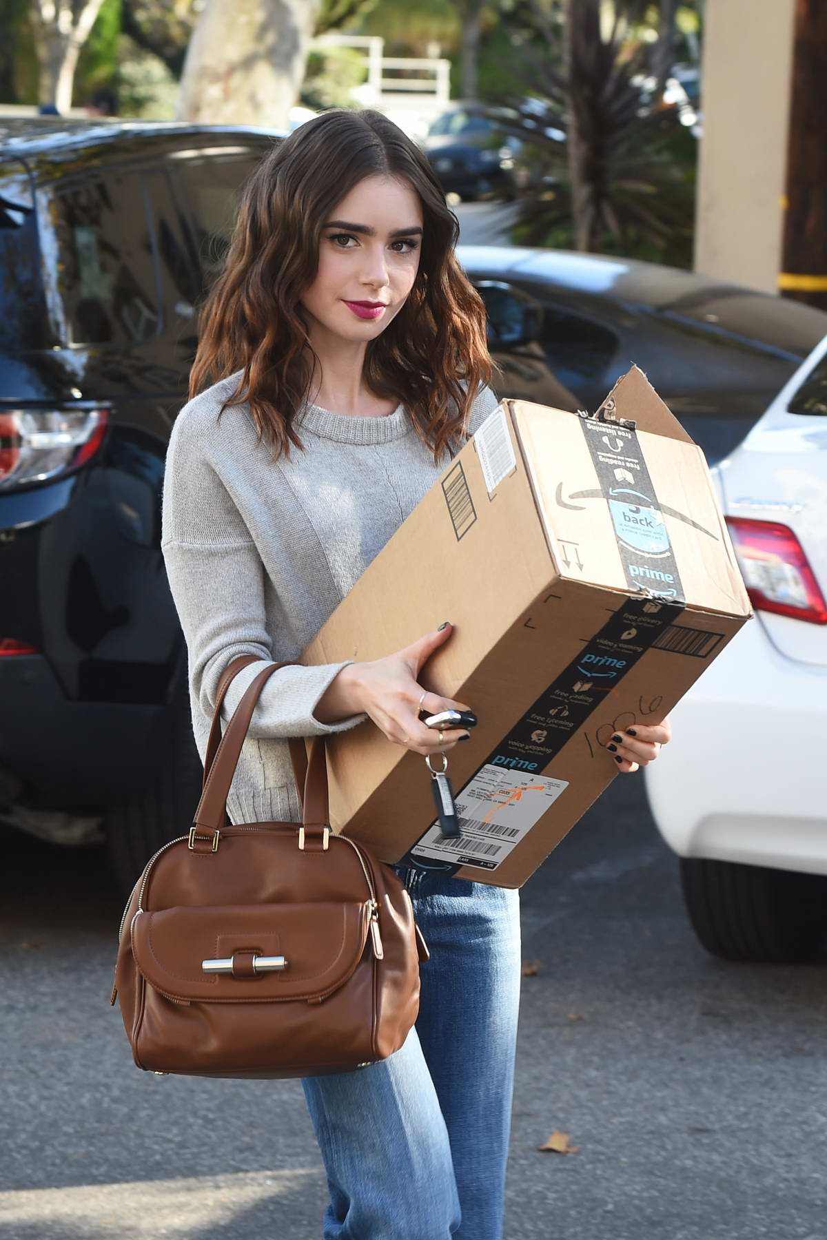 Lily Collins drops off a package at the FedEx office print & ship center in Beverly Hills, Los Angeles