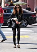 Lily Collins enjoys a fresh squeezed juice while out in Los Angeles