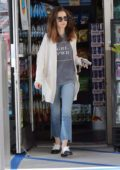Lily Collins shows of her 'Grl Power' as she spends a day running errands in West Hollywood, Los Angeles