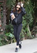 Lily Collins wears a bomber jacket while leaving the gym in West Hollywood, Los Angeles