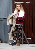 Lily James seen leaving her north London home wearing a cast on her foot with Matt Smith
