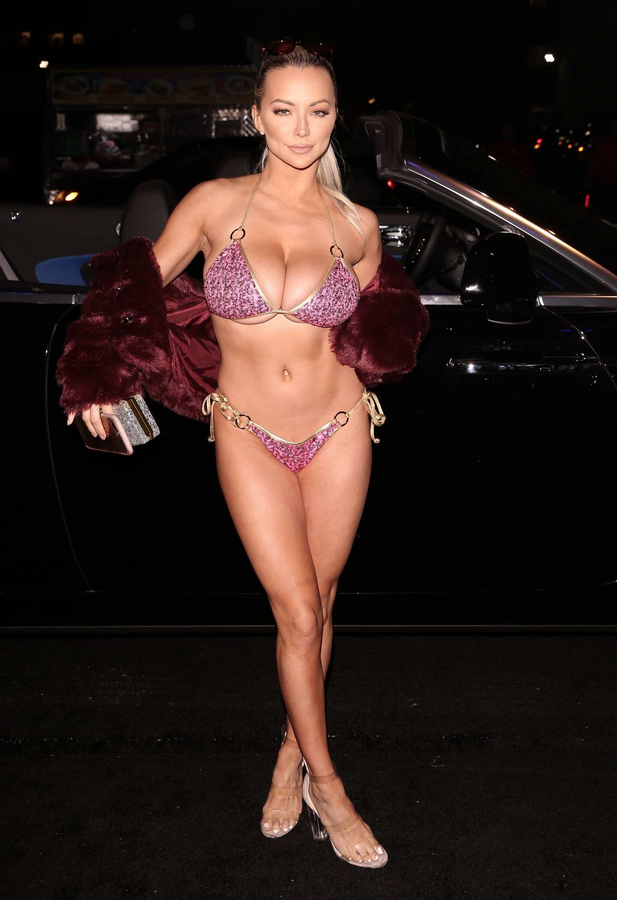 Lindsey Pelas in a bikini arrives to Treats Magazine Halloween party in Los Angeles