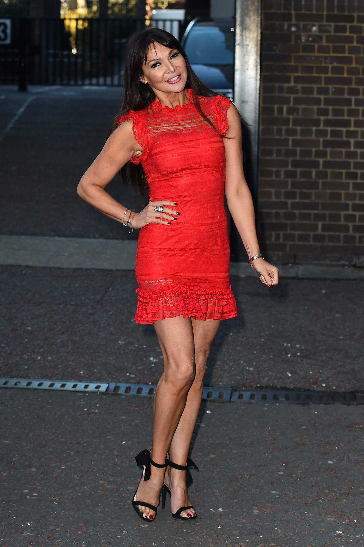 Lizzie Cundy in a red dress spotted outside ITV studios in London