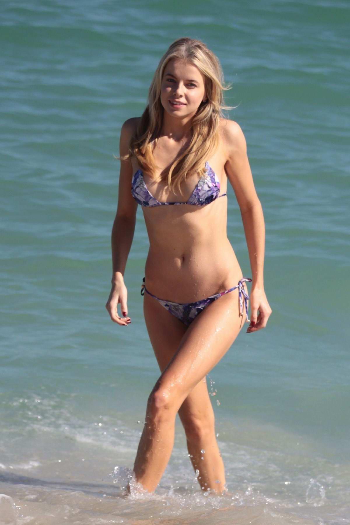 Louisa Warwick in a violet bikini enjoying a day on the beach in Miami, Florida