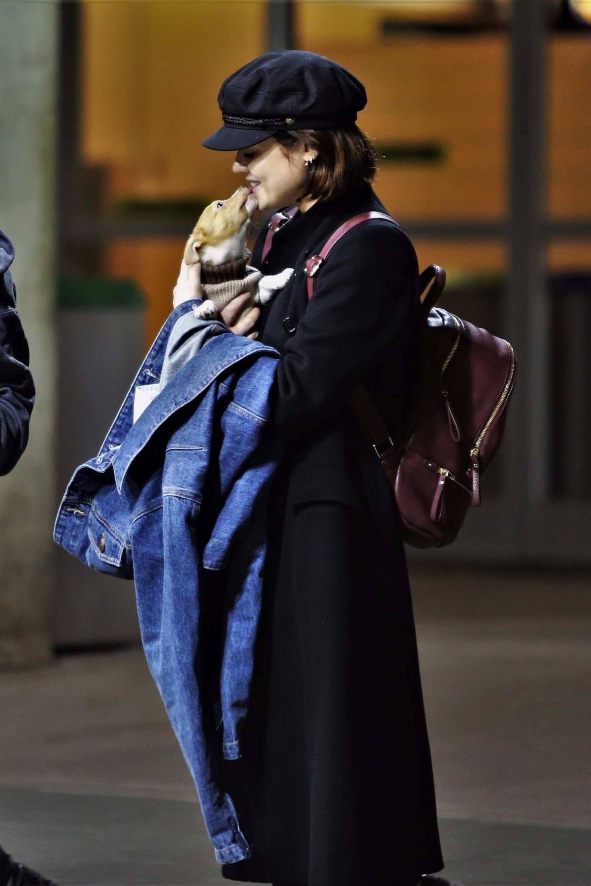 Lucy Hale let her new puppy out of airline carrier at the airport in Vancouver, Canada