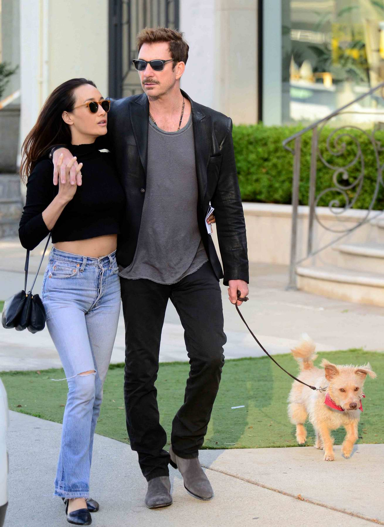 Maggie Q and boyfriend Dylan McDermott out for a walk with their dog on Melrose Avenue in West Hollywood, Los Angeles