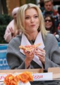 Megyn Kelly eats pizza at Access Hollywood in New York