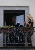 Michelle Hunziker poses on a balcony as her daughter Aurora takes photos in Milan, Italy