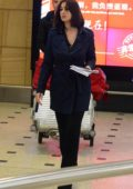Monica Bellucci spotted at the airport as she touch down in Sydney, Australia