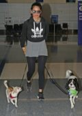 Olivia Munn spotted with her dogs at LAX Airport as she flies out of Los Angeles