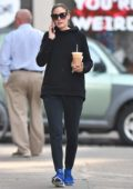 Olivia Palermo wearing workout gear while getting coffee in Brooklyn, New York