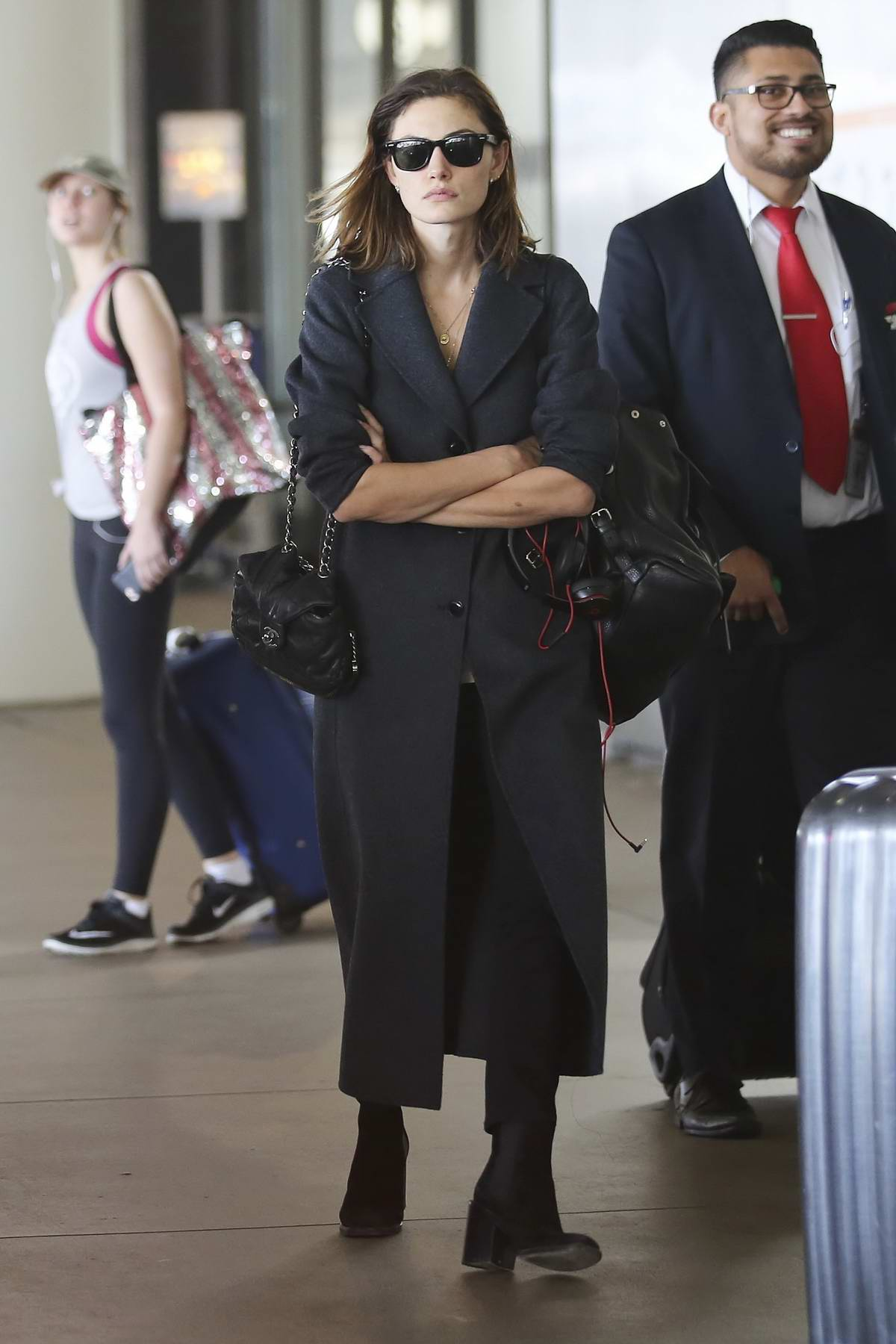 Phoebe Tonkin and her new boyfriend are seen leaving LAX airport in Los Angeles