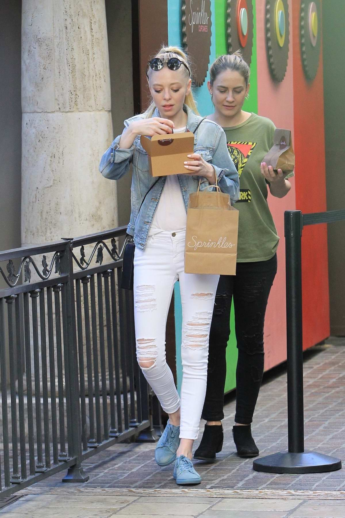 Portia Doubleday stops for a sprinkles cupcakes snack with a friend at The Grove in West Hollywood, Los Angeles