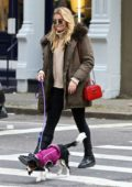 Rachel Hilbert out for a walk with her dog in SoHo, New York City