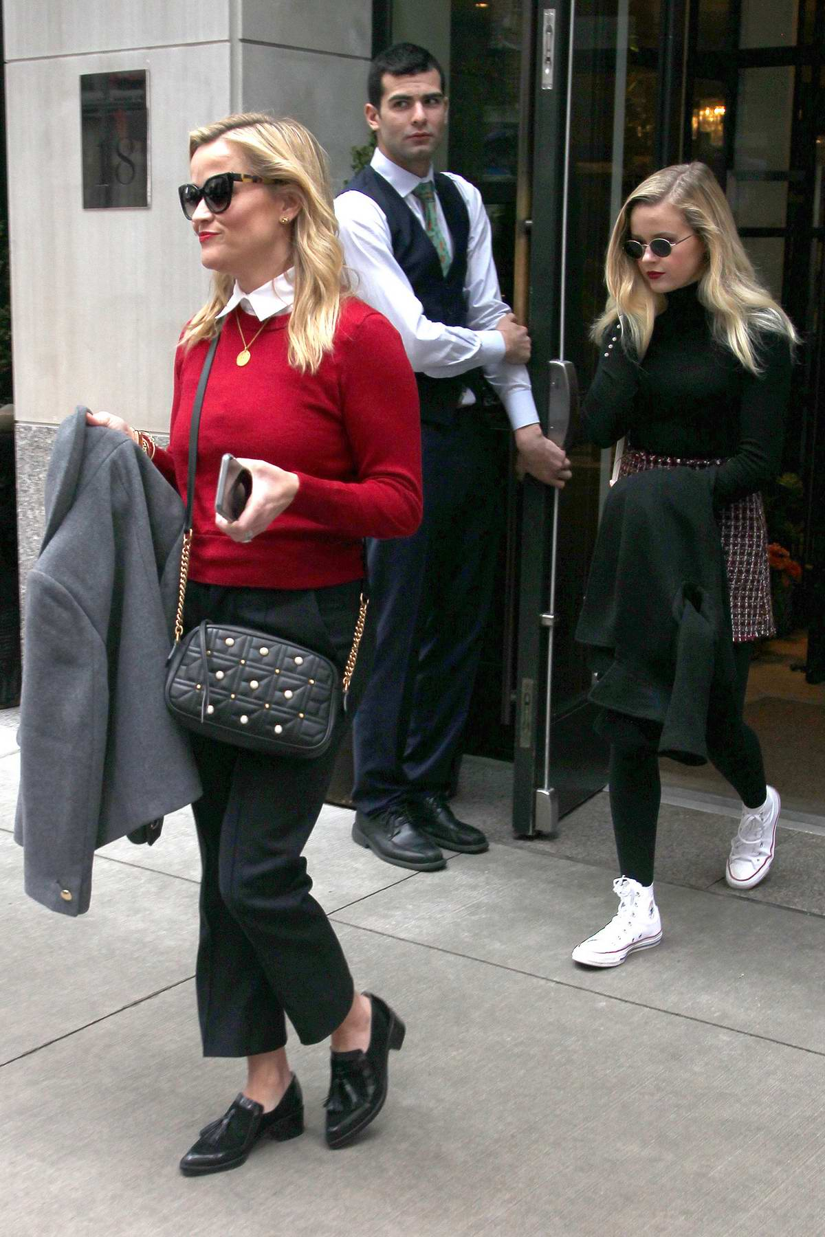 Reese Witherspoon with daughter Ava Phillippe and Zoe Kravitz step out of their hotel for a day out in New York City
