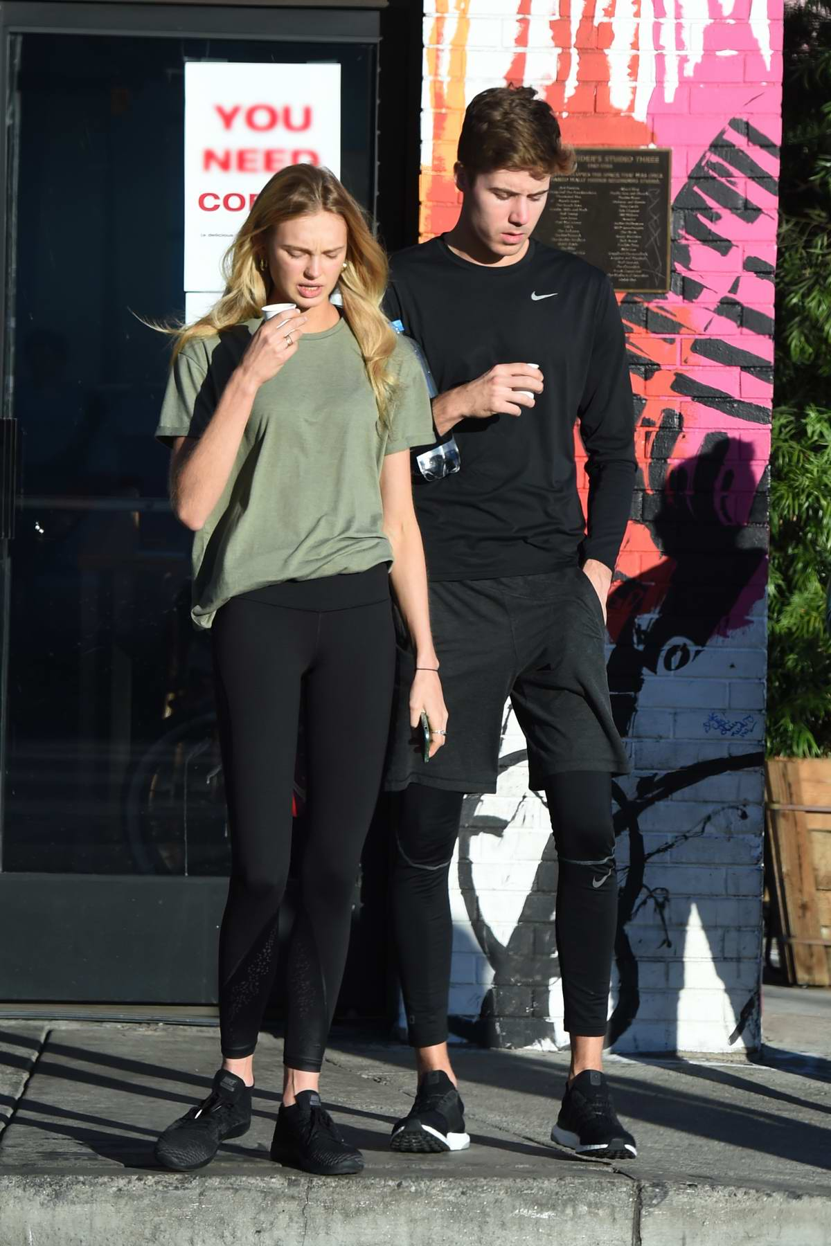Romee Strijd and boyfriend Laurens van Leeuwen take a shot of healthy juice as they head to the gym for a workout in Los Angeles