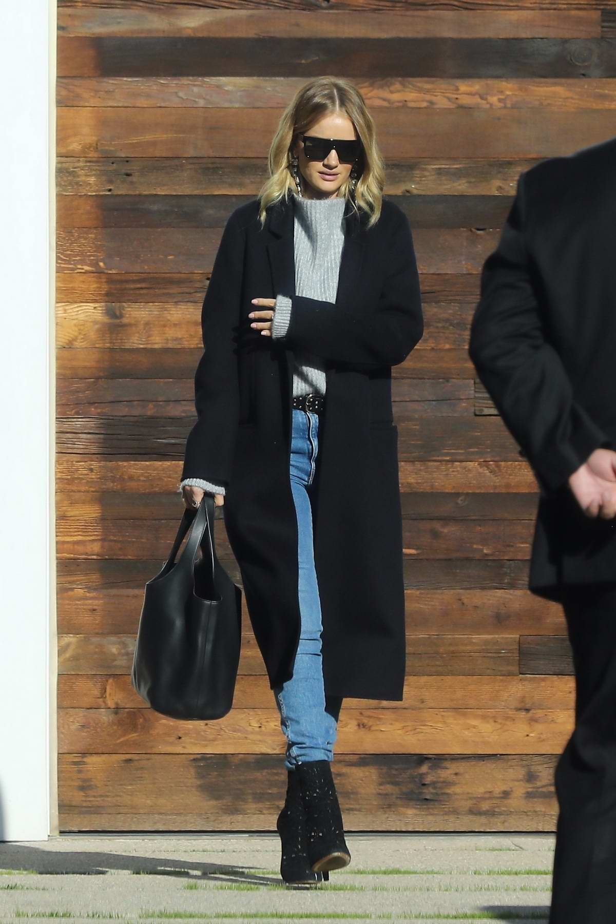 Rosie Huntington-Whiteley heads for a meeting in a long black coat with matching shoes in Los Angeles